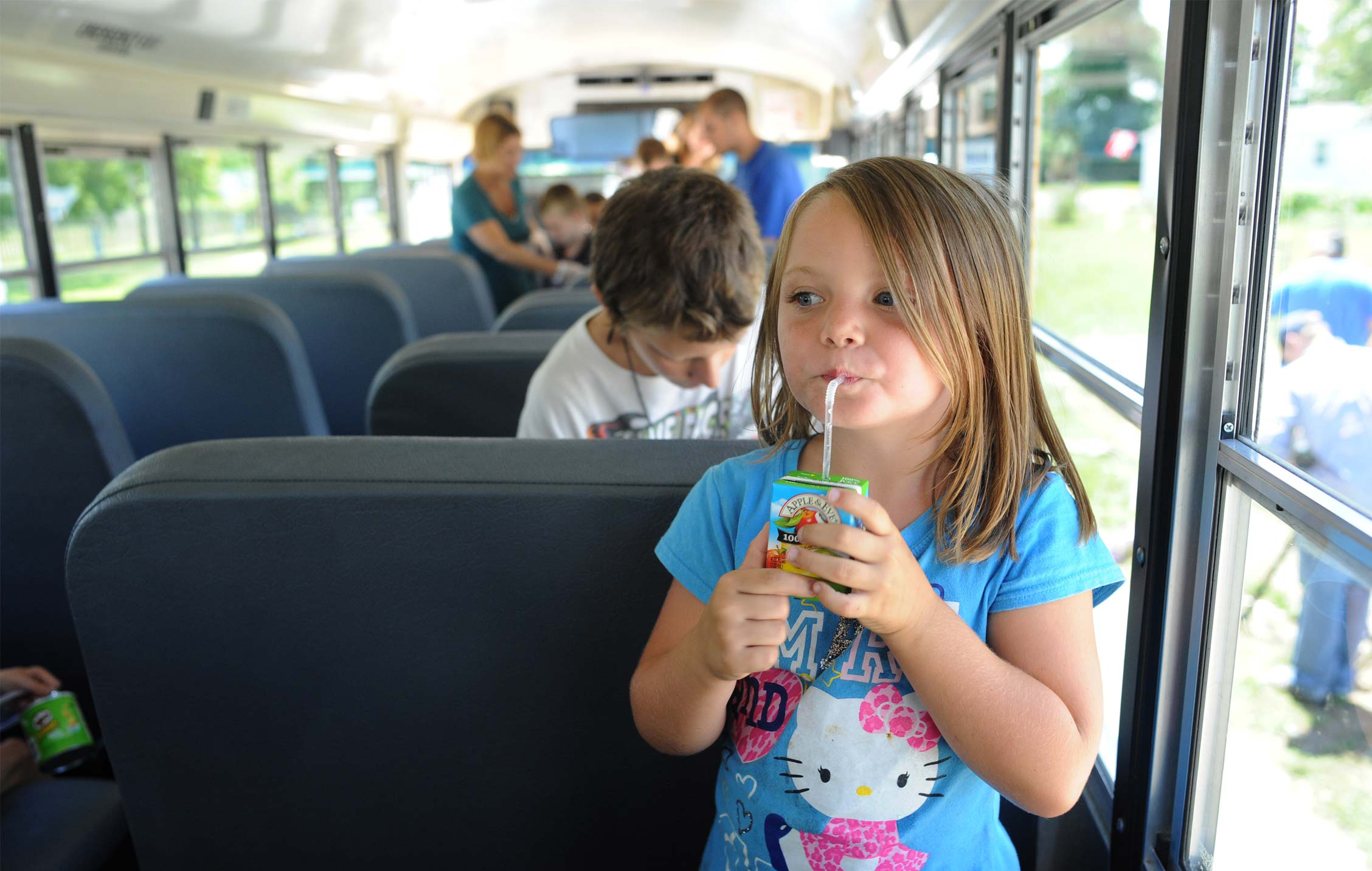 A young girl on a bus, in a program fundedby Red Nose Day donations.