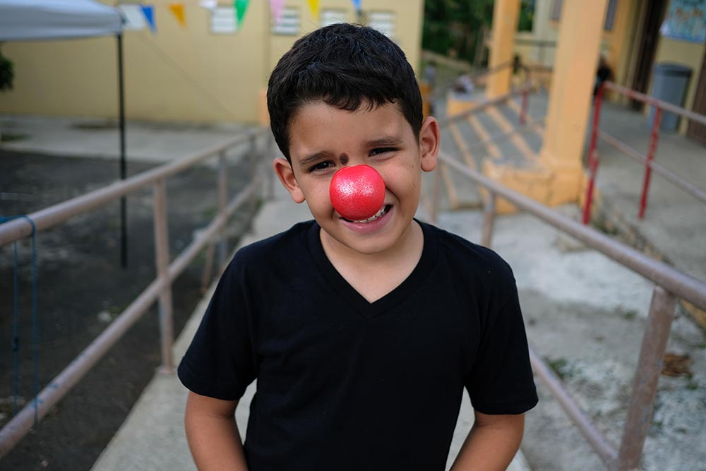 A young boy in Puerto Rico wearing a Red Nose.