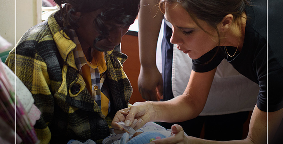 Victoria Beckham administers a vaccine to baby David.